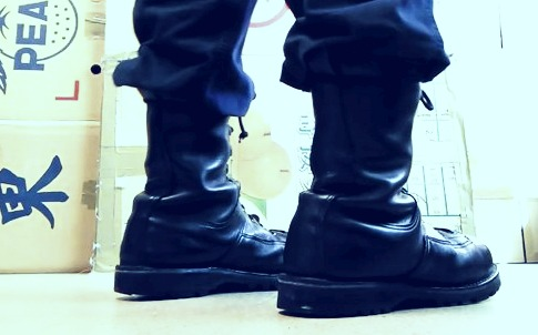 police boots along men standing