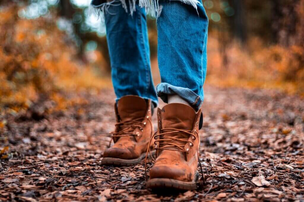 Brown boots with laces and blue jeans